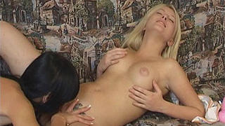 Teen lesbians playing with toy