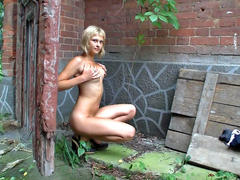 teen whore plays with dildo outdoor